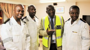 MARITIME MOVES: SA Maritime Safety Authority (SAMSA) CEO, Commander Tsietsi Mokhele (Second Right) with three of the country's first set of learner seafarers to be placed on a South Africa registered commercial vessel, the Cape Orchid at Saldanha Bay in October 2015. The young cadets now have a dedicated professional regulatory institute to safeguard their professional interests inclusive of ongoing life long learning, the Institute of Professional SA Mariners (IPSAM).