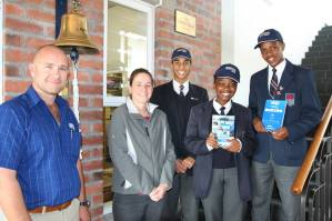 LENDING A HAND: Subetch South Africa officials, Mr Rudolph Punt and Ms Mandy McGuire (Subtech) with the pupils Gershwyn Poole, Siyamthanda Vuyelwa and Phaphama Kepu who were recently awarded bursaries at Lawhill High School