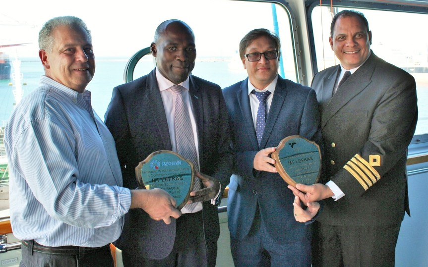 WELCOME ON BOARD THE MT LEFKAS: Displaying plaques denoting the formal registration of Aegean's bunkering services vessel, the MT Lefkus under the South African flag in Port Elizabeth on Wednesday are (From Left) Aegean fishing group Eastern Cape regional manager Mr Kosta Argyros, SAMSA acting CEO, Mr Sobantu Tilayi, port of Port Elizabeth manager Mr Rajesh Dana and port of Port Elizabeth harbour master, Captain Brynn Adamson