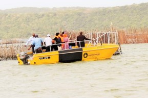 Transport Department Deputy Minister, Ms Sindisiwe Chikunga (in black outfit) and some senior government officials at provincial and local government level in KwaZulu-Natal, as well as SAMSA acting CEO, Mr Sobantu Tilayi on board a boat donated by private sector companies to the water-locked community of Enkovukeni at Umhlabuyalingana on the north coast of KwaZulu Natal on Friday