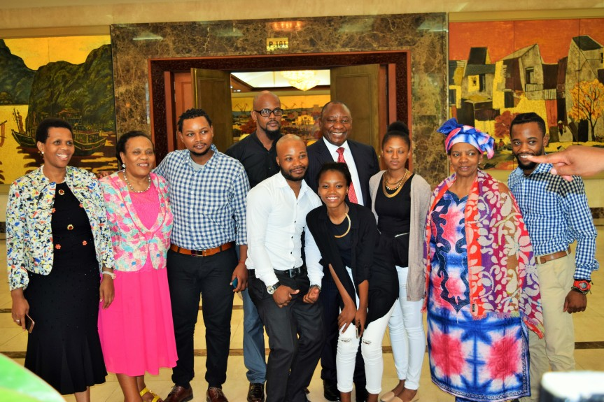 South African maritime studies students in Vietnam (third from Left) Zenzele Makukula, (infront leaning forward) Mandisa Mthembu, (third from Right) Kentse Matshira and (extreme Right) Mpumelelo Ndebele; with South Africa's Deputy President, Mr Cyril Ramaphosa and members of his delegation during a stop over in Vietnam on October 4, 2016.