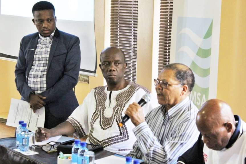 South Africa's National Heritage Council (NHC) CEO Advocate Sonwabile Mancotywa (seated Left) listening attentively to Commander Fanele Mbali, one of only five surviving members of the uMkhonto Wesizwe (MK) naval unit, relating the unit's endeavors to use the seas during the liberation struggle of the 1970s. The unit's story of a vessel known as the Aventura was shared as part of this year's observance of World Maritime Day at the Xhariep Dam in the Free State