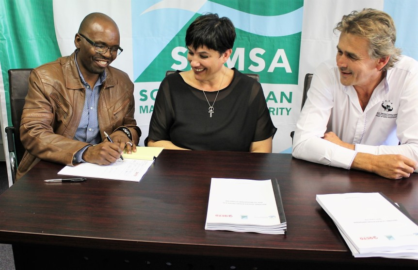PUTTING PEN TO PAPER: Officials involved in the development of eight (8) maritime sector national occupation qualifications curriculum (From Left) Henry Maringa, Mrs Yolandi Raath-Booyens and Mr Victor Muhlberg during the handover of the qualifications curriculum to the Quality Council of Trades and Occupations (QCTO) in Cape Town this week.