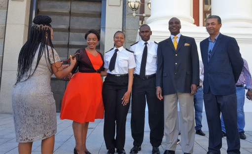 Deputy Transport Minister, Ms Sindisiwe Chikunga (Left) and (former) Transport Minister Mr Joe Masangwanyi (Right ) with Ayanda Miya and Mluleki Khwela - two of the SA Agulhas cadets that returned with the vessel from a trip to Antarctica over 80 days in November 2017 to January 2018. They were invited for the opening of South Africa's Parliament in